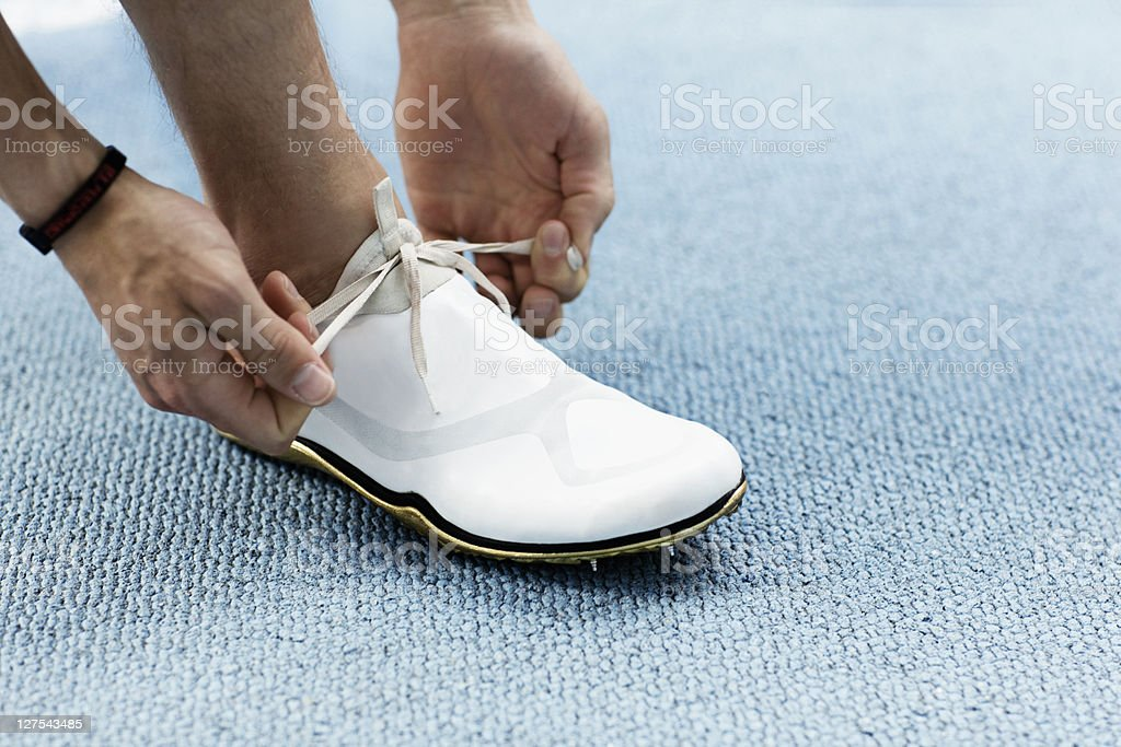 Runner tying shoelaces stock photo