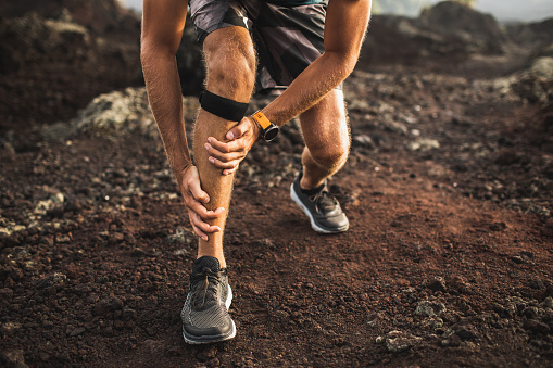 istock Runner using Knee support bandage and have a problem with leg injury on running. Periosteum problem or sprain ligament. 1164802154