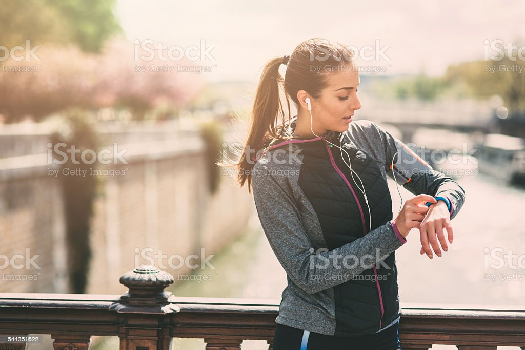 Runner using smart watch stock photo