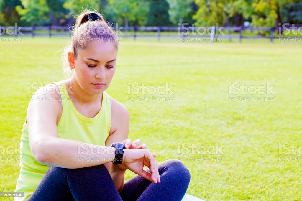 Runner using smart watch royalty-free stock photo