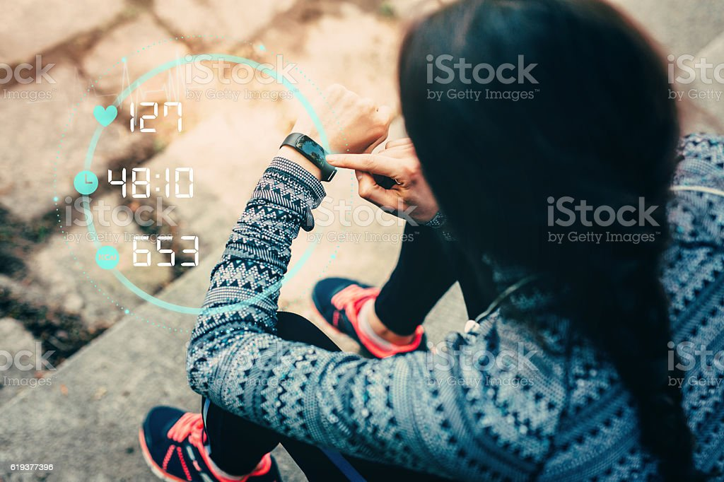 Runner using smart watch royalty-free stock photo
