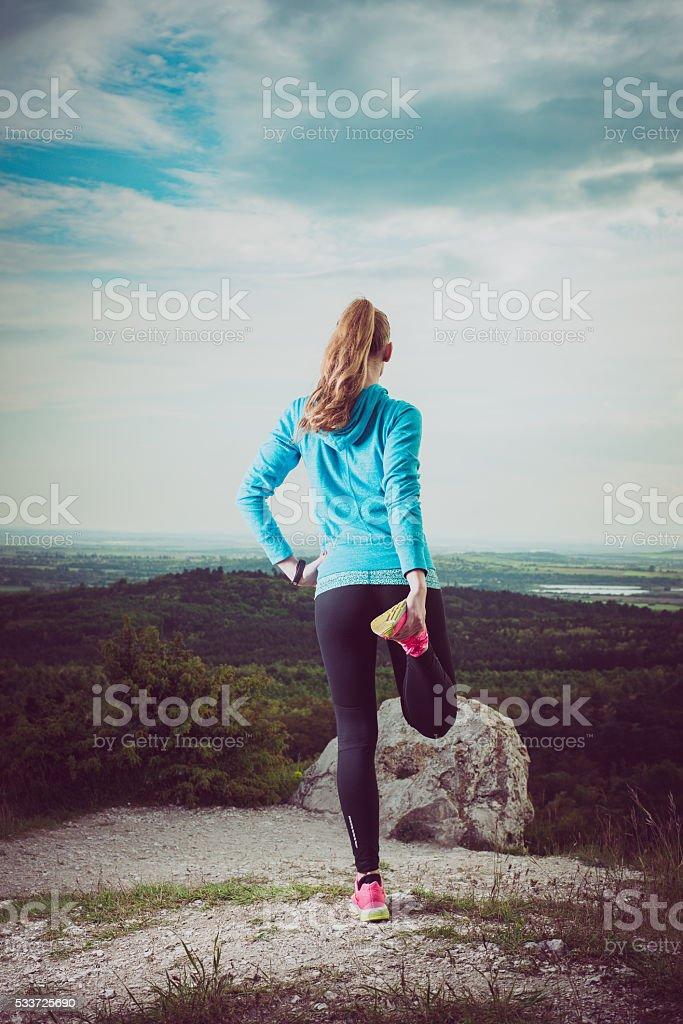 Runner Warming Up Before Running, watching landscape stock photo