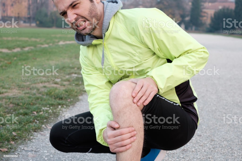 Runner with injured ankle while training stock photo
