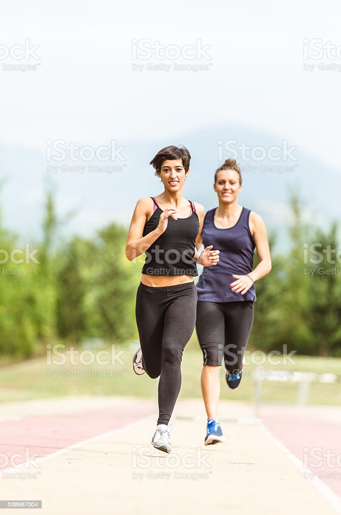 runner woman at the race stock photo