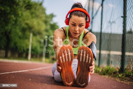 520047182istockphoto Runner woman doing hamstring stretch after jogging 969624990