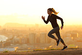 istock Runner woman running in the outskirts of the city 1217027487