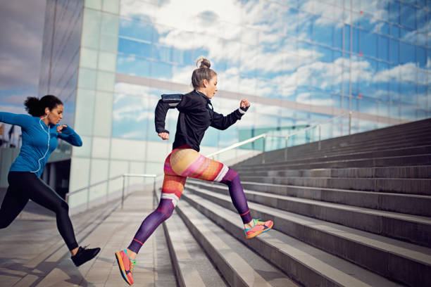 Runner women are sprinting in a competition stock photo