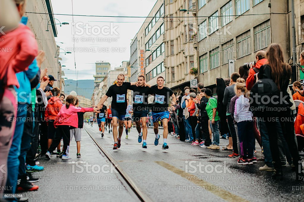 Runners are celebrating the finish stock photo