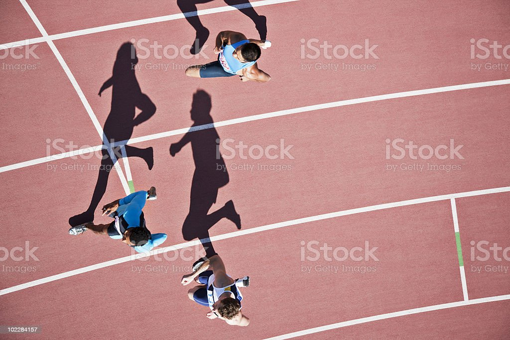 Runners competing on track royalty-free stock photo