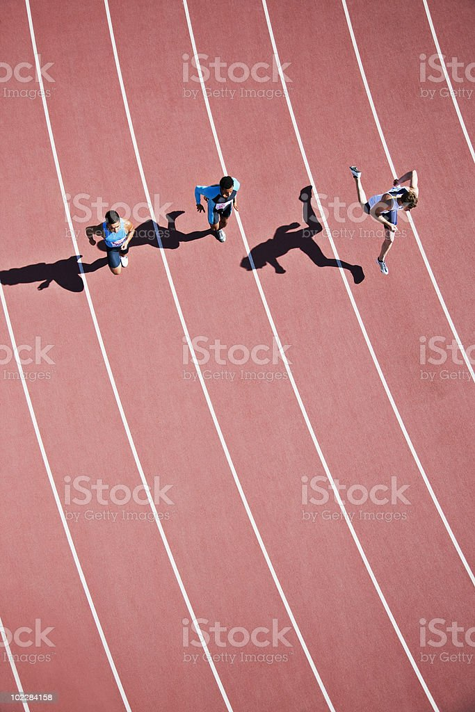 Runners competing on track stock photo