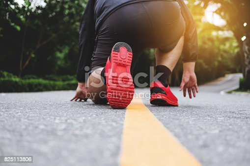 Runner's feet running on the road in public parks, run for losing weight