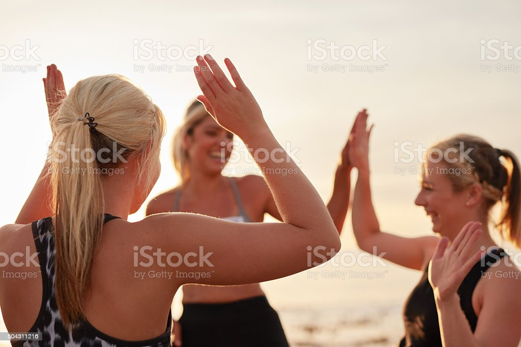 Runners giving high five stock photo