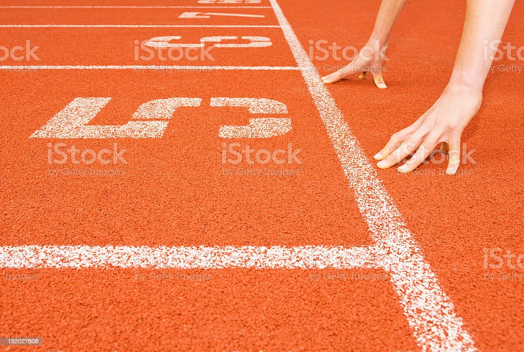 Runner's Hands at the Starting Line royalty-free stock photo