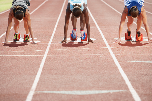 Runners In Starting Blocks Stock Photo - Download Image Now