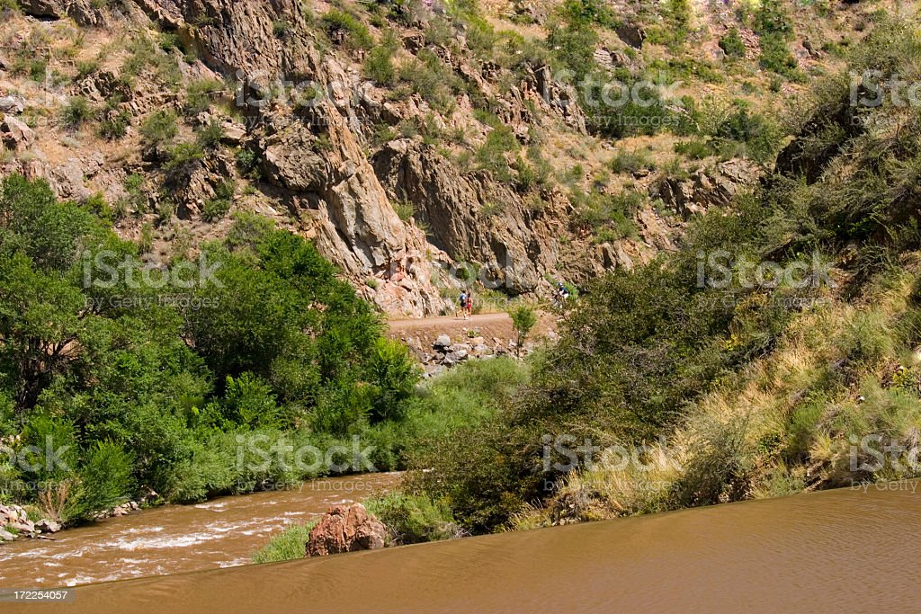 Runners in Waterton Canyon Colorado royalty-free stock photo