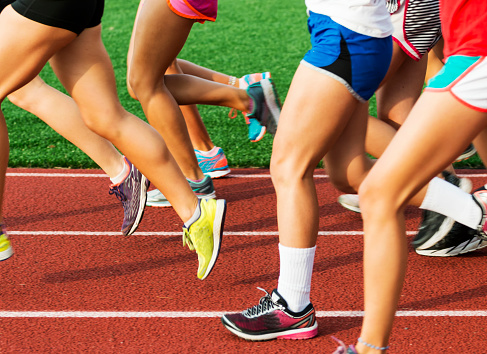 istock Runners legs on a red track 849380490