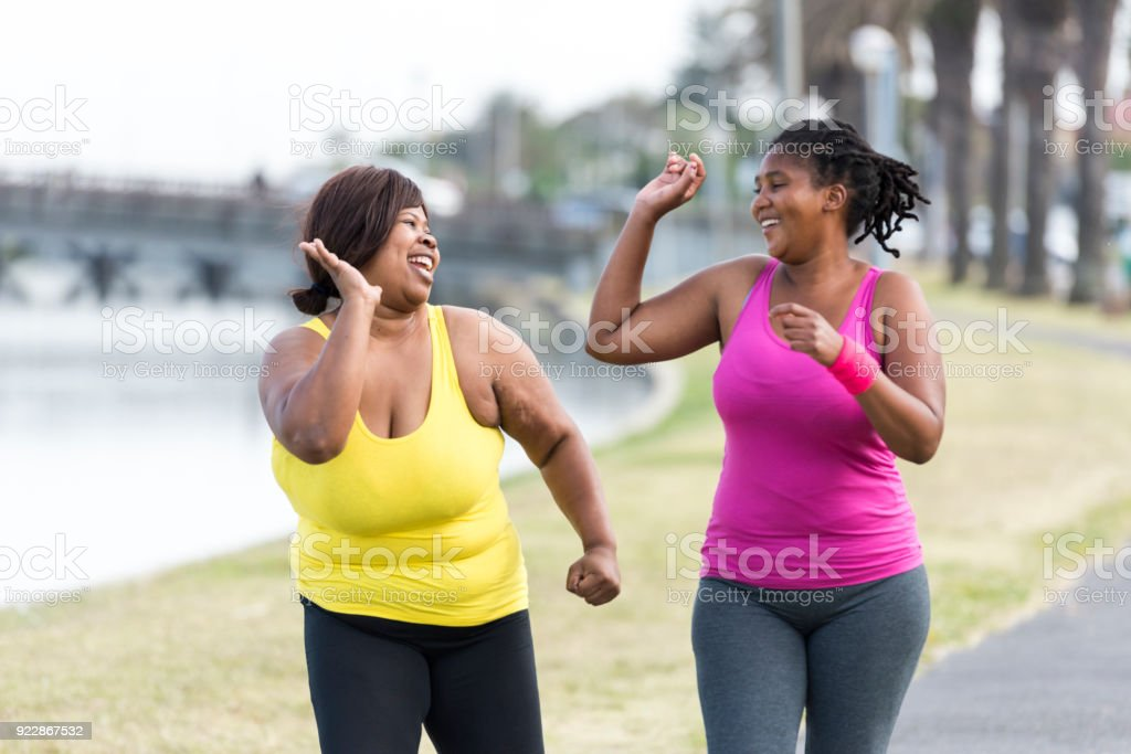 Runners motivating each other stock photo