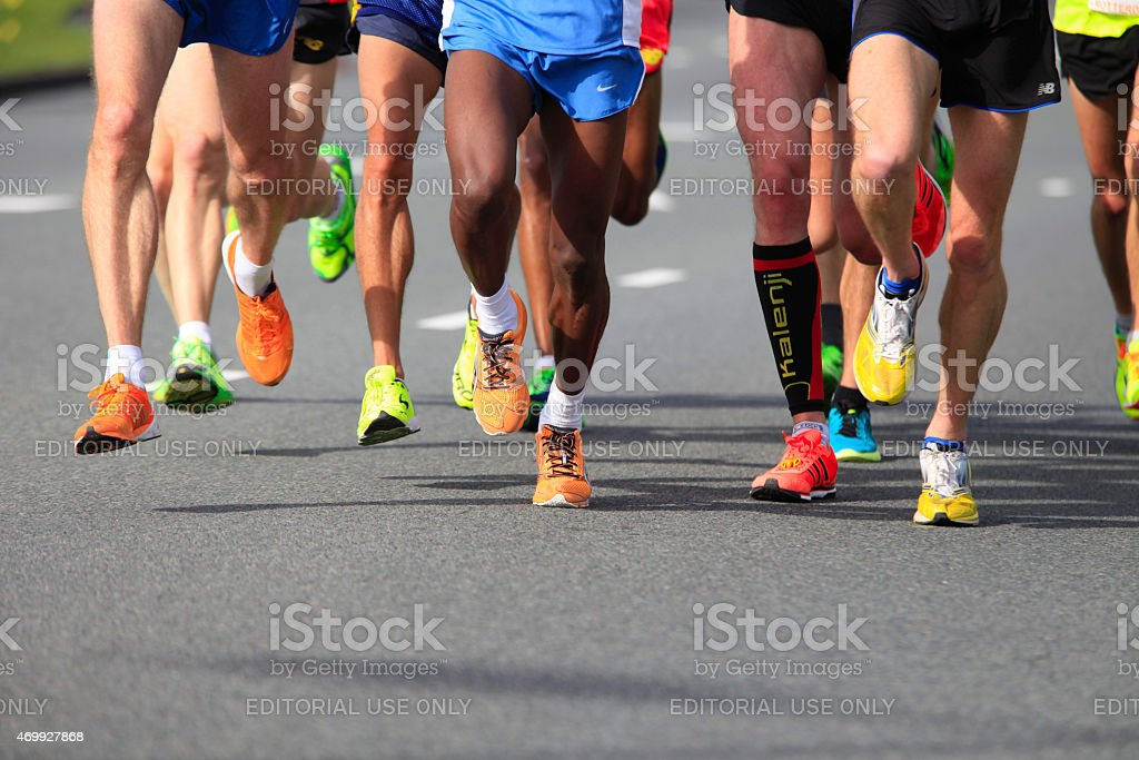 runners on sport shoes of Saucony, Brooks and Adididas stock photo