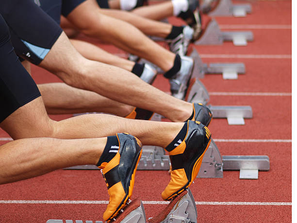 Runners on starting blocks  track starting block stock pictures, royalty-free photos & images