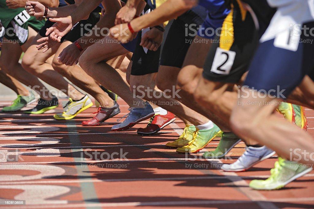 Runners on starting line stock photo