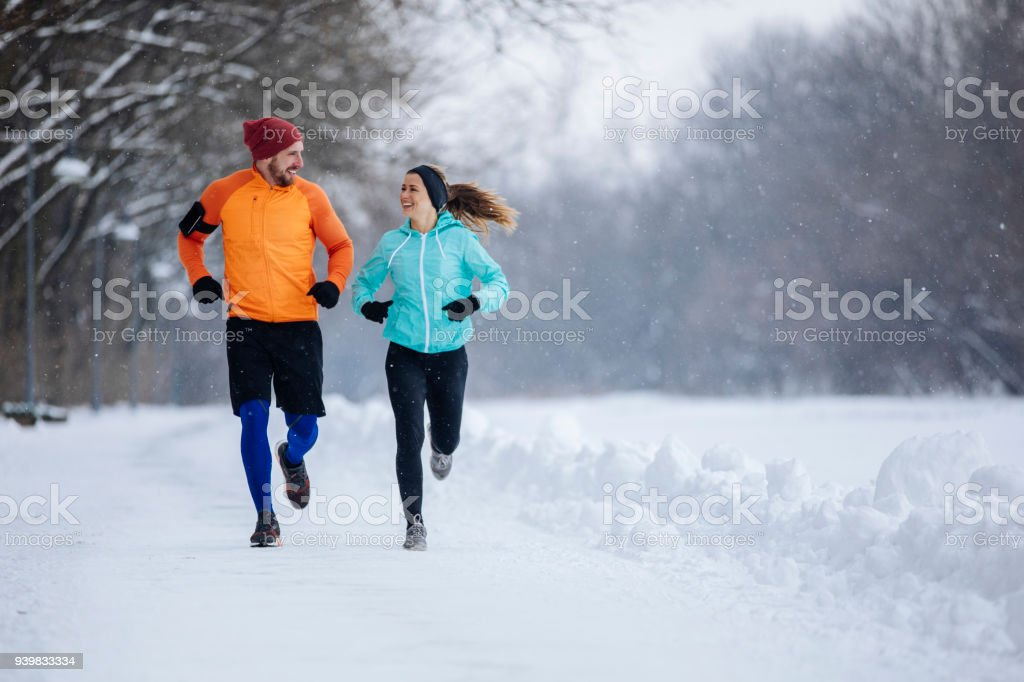 Runners on the snow stock photo