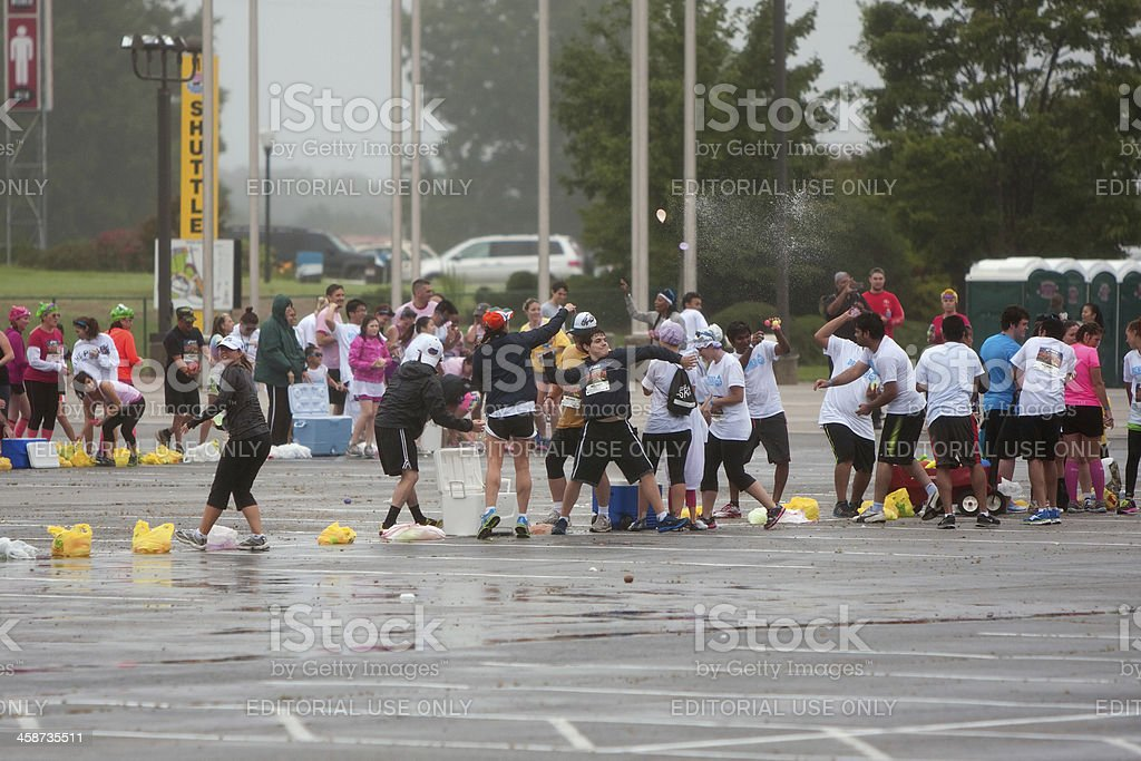 Runners Participate In Huge Water Balloon Fight After Running Race royalty-free stock photo