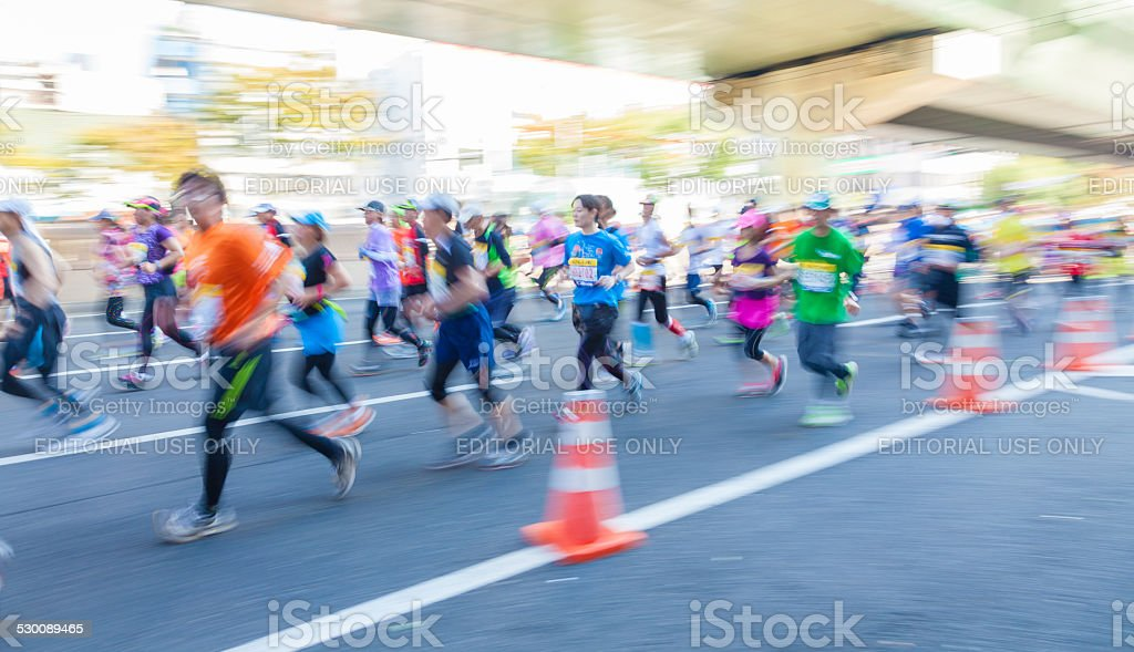 Runners participating in the 2014 Osaka Marathon stock photo