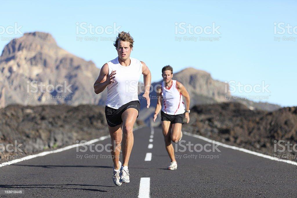 Runners running on road stock photo