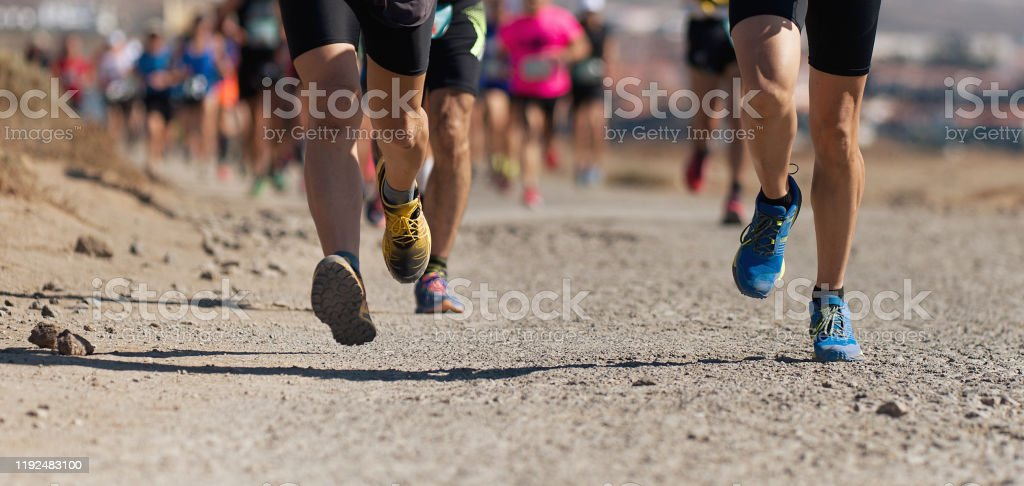 Runners running shoes on trail run - Royalty-free Active Lifestyle Stock Photo