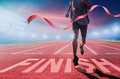 istock Runners running towards the finish line. 1300123069