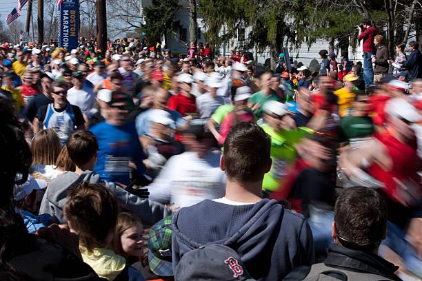 runners start the boston marathon - boston marathon stock photos and pictures