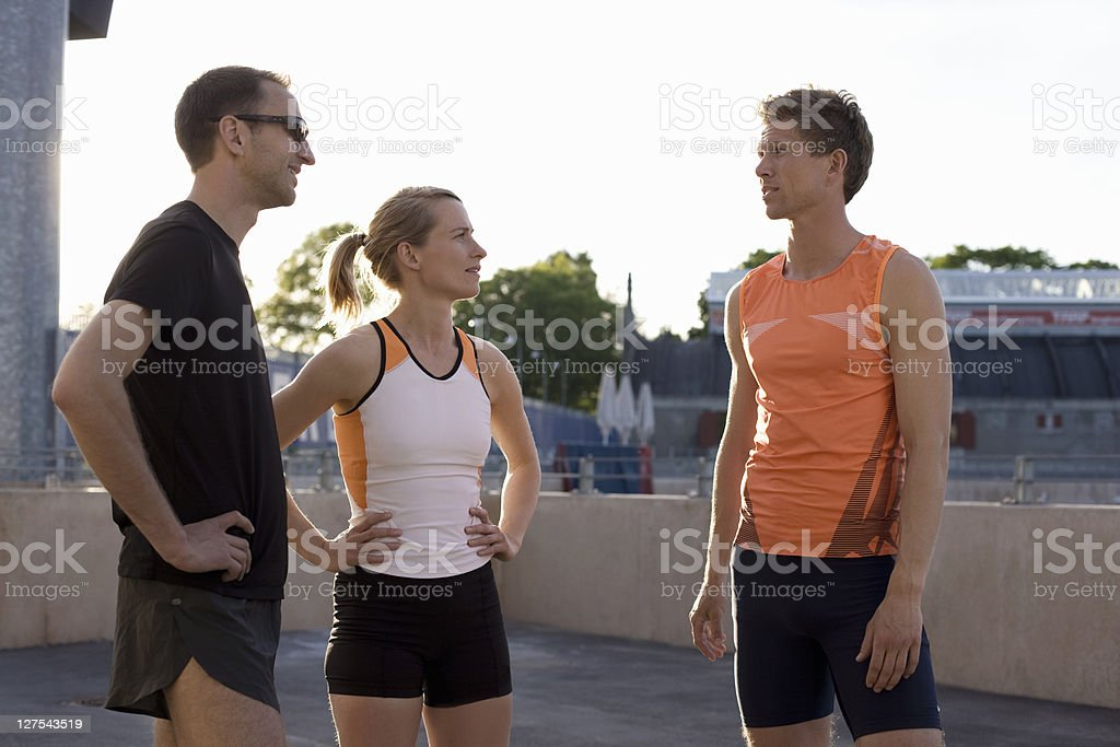 Runners talking together stock photo