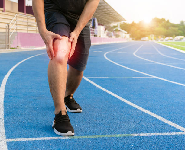 Runners to exercise knee joint bone Inflamed stock photo