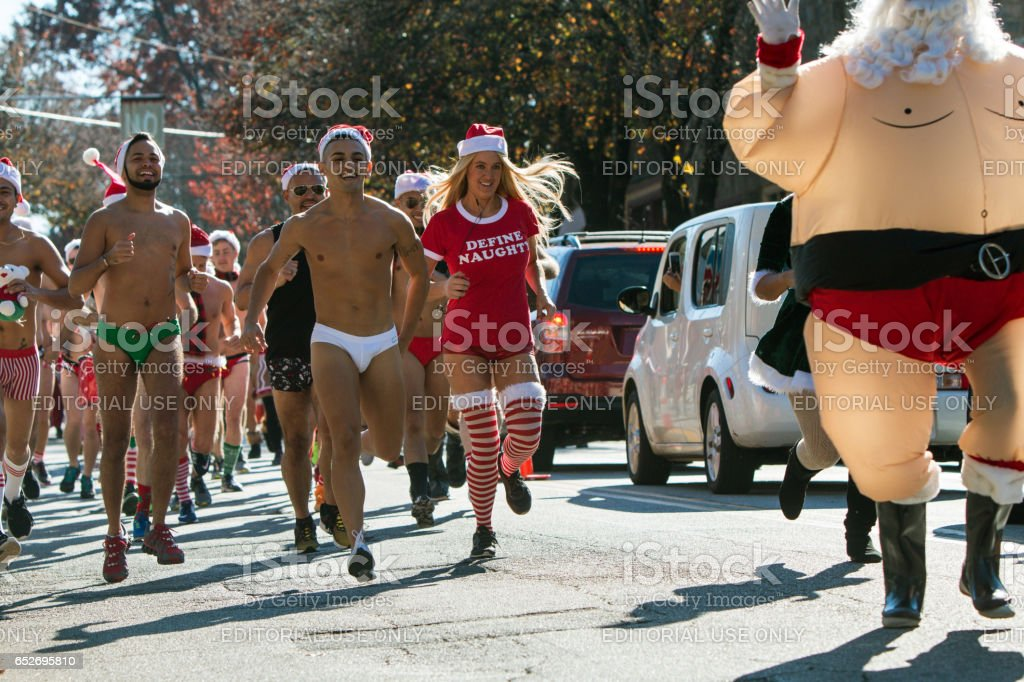 Runners Wearing Speedos Jog Down Street In Eclectic Atlanta Race stock photo