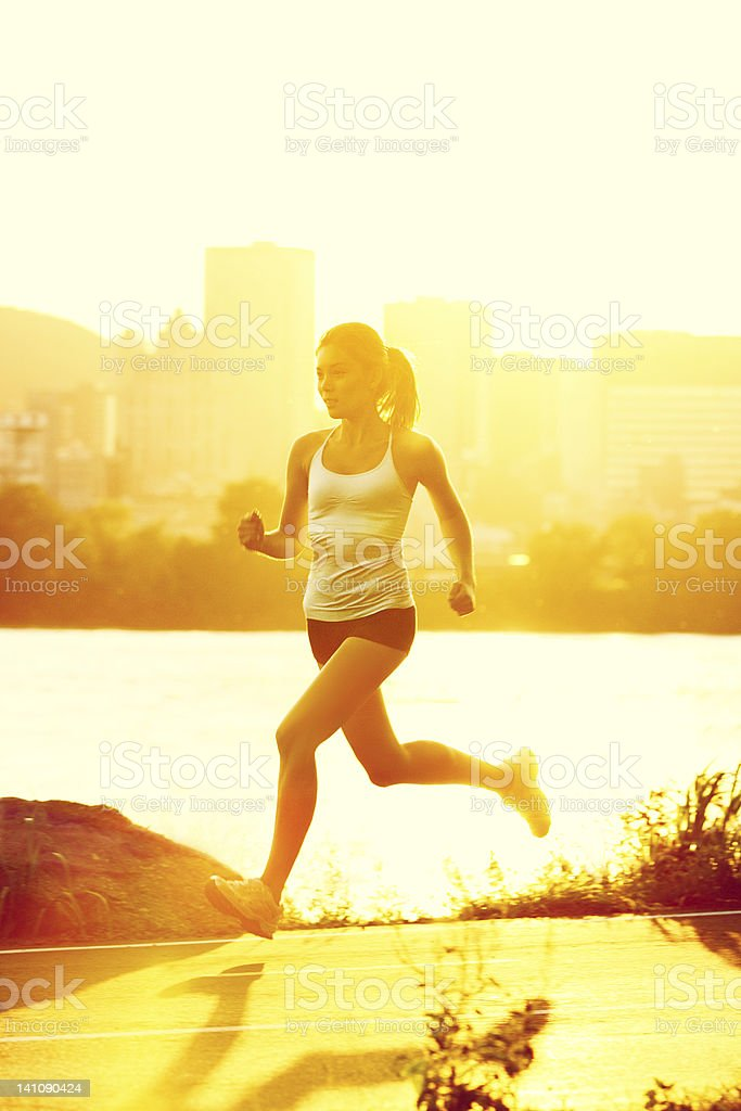 Runners - woman running stock photo