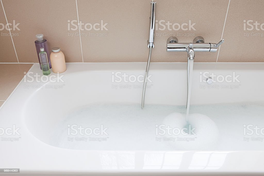 Running a bath royalty-free stock photo
