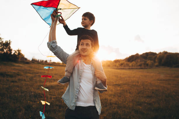 Running a kite with my dad stock photo