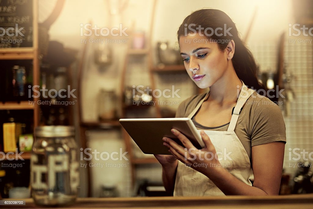 Running a modern cafe wouldn't be complete without modern technology stock photo