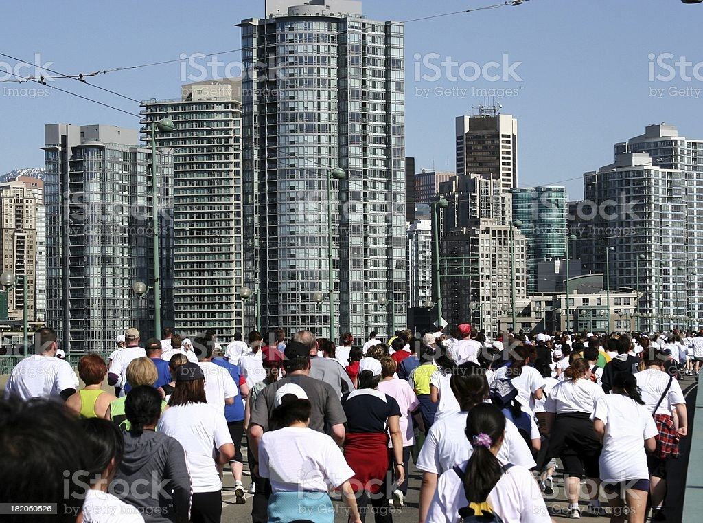 A mass of runners on the Cambie Street Bridge in Vancouver during an...