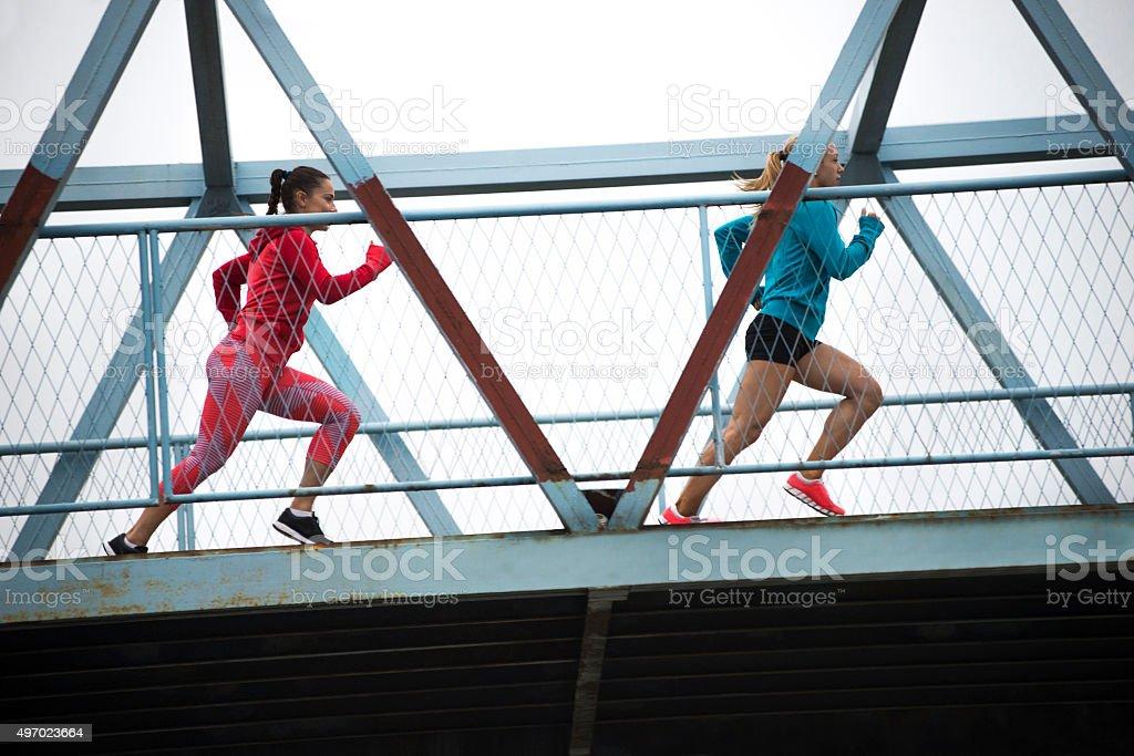 Running across the bridge stock photo