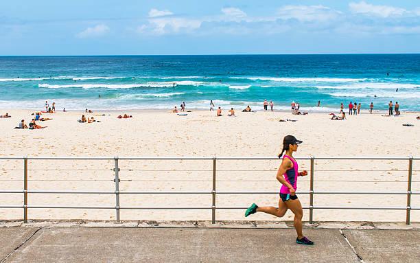Running at Bondi Beach stock photo