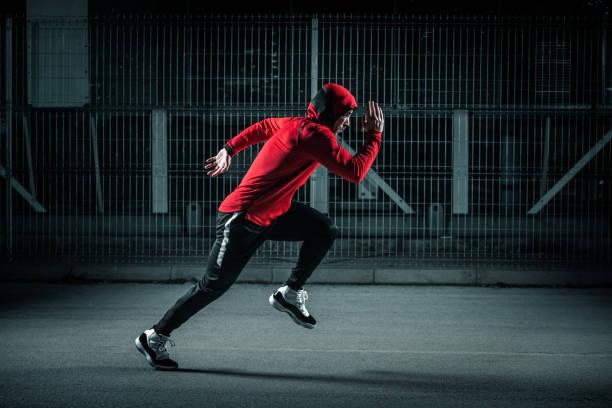 Running at night stock photo