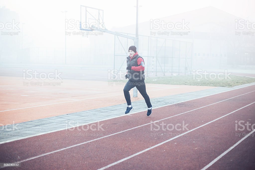 Running athlete exercising for fitness and health outdoors stock photo