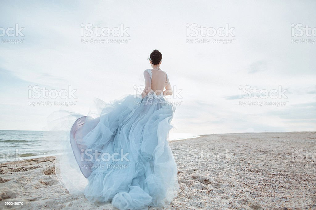 Running bride on the beach royalty-free stock photo