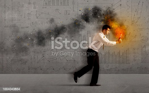 513396643 istock photo Running business man with fire laptop 1004040854
