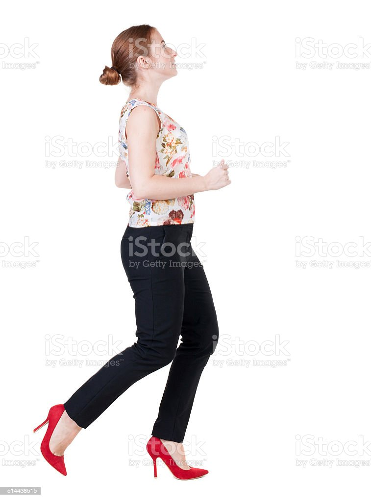 running business woman. back view. going young girl in  suit. stock photo