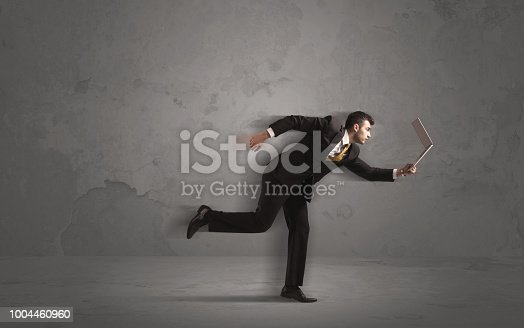 513396643 istock photo Running businessman with device in hand 1004460960