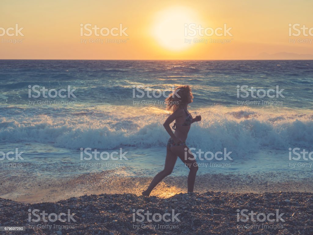 Running by the beach royalty-free stock photo