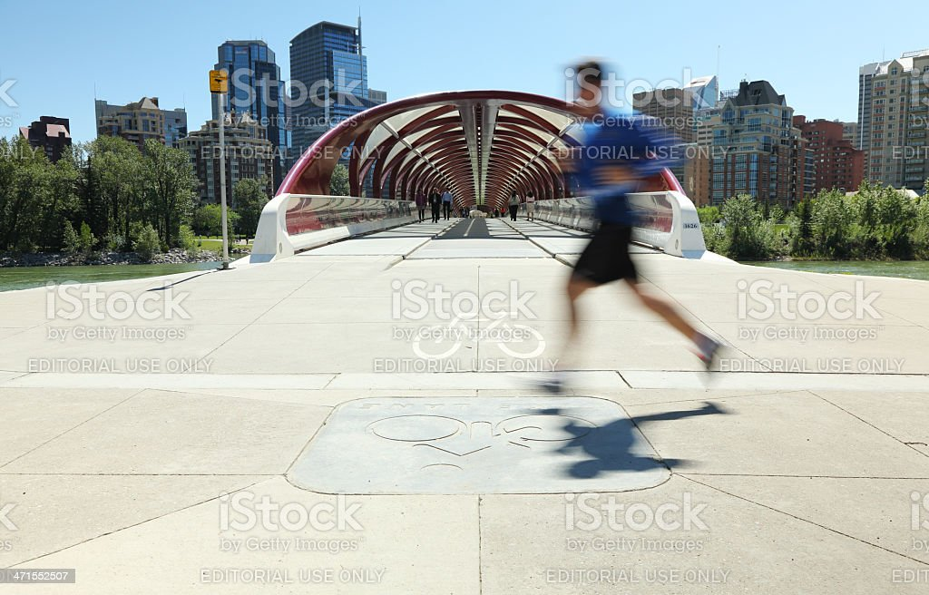 Running By The Peace Bridge royalty-free stock photo
