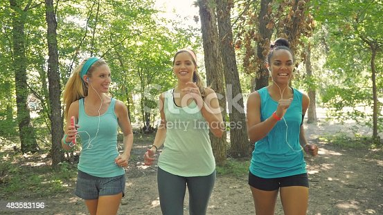 1051098428 istock photo Running club exercising on dirt trail together in park 483583196